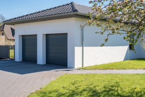 Modern,And,Luxurious,Double,Garage,With,Driveway,And,Roller,Door